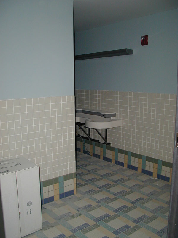Bathrooms have been tiled and fixtures are being installed.