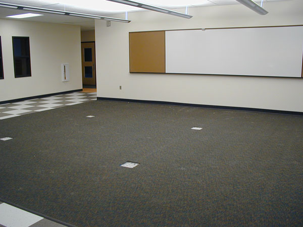 On the first floor, the team resource area between the kindergarten and first-grade classrooms is complete. Cabinets are located at the other end of the shared resource area.